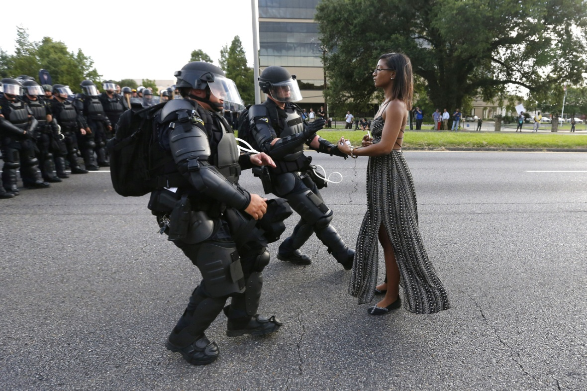 A demonstrator protesting the shooting death of Alton Sterling is detained by law enforcement near the headquarters of the Baton Rouge Police Department in Baton Rouge, Louisiana